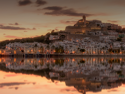 View of Old Town and castle in Ibiza at sunset.